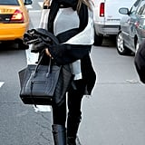 Alessandra Ambrosio styled a black scarf with her colourblock jumper.