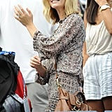 Brooklyn Decker watches tennis.