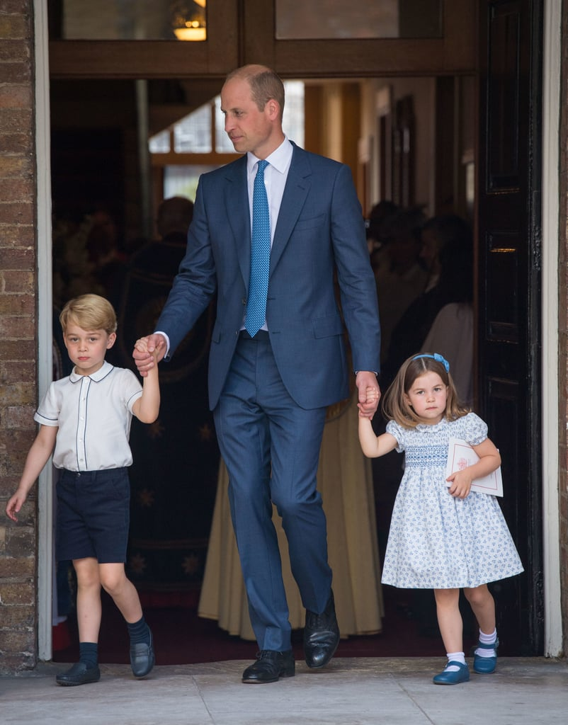 The British royal family celebrated the christening of Prince Louis on Monday, and though the 2-month-old prince was clearly front and center, his older siblings were in their usual form, doing their very best to steal the show. The two young royals held on to Prince William's hand as they made their way inside the Chapel Royal at St. James's Palace in London. While George donned his usual uniform of shorts and a button-down shirt, Charlotte looked cute as can be in a blue-and-white dress and matching headband. The year has been a big one for the royal family, George and Charlotte included. Prince George and Princess Charlotte have been winning us over all year, from their adorable appearance at Prince Harry and Meghan Markle's wedding to those cheeky photos snapped on the balcony at Trooping the Colour. Four-year-old George is clearly having the time of his life, and Charlotte continues to melt our hearts with every new photo. We can't wait to see how their new sibling fits into the family over the coming years, and we look forward to even more heartwarming family appearances to come.