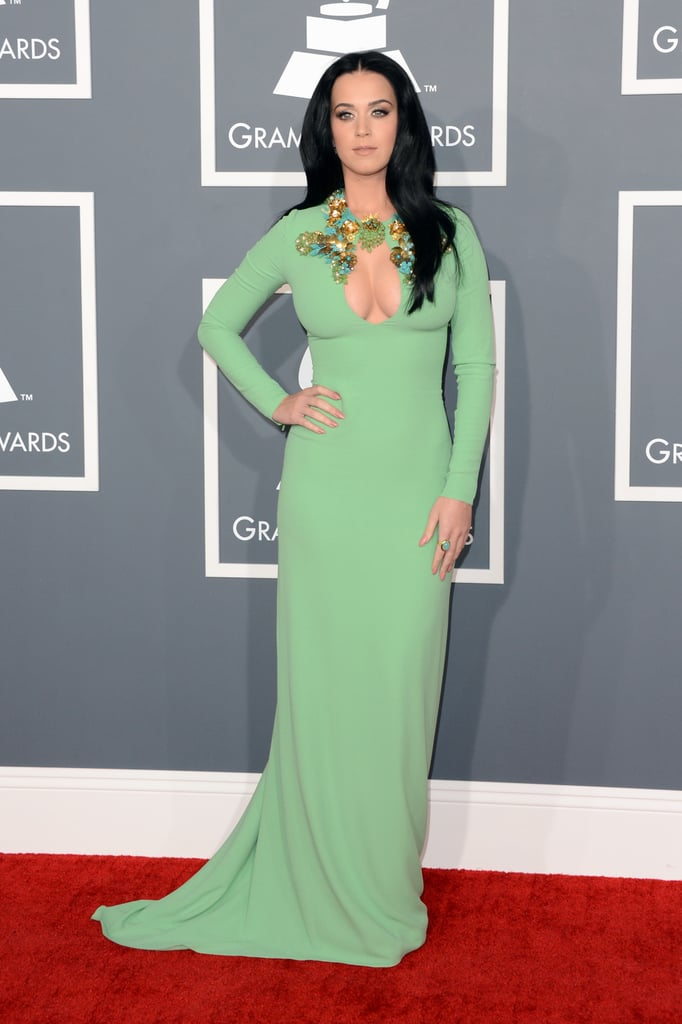 "Katy Perry posed for photos in a sexy Gucci gown as she arrived at the Grammy Awards in LA tonight. Katy didn't bring along boyfriend John Mayer to the red carpet, instead choosing pal Allison Williams as her date. Earlier this week, Allison chatted about her friend Katy, saying, ""She's the hottest date. She's a friend of mine, and she's nominated, as she should be."" Katy will have plenty of support if she takes home the win for best pop solo performance for ""Wide Awake."" Even if she's not the winner, Katy will take the stage as a presenter during the show."