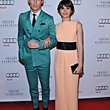 Eddie Redmayne and Felicity Jones made a colorful pair on the red carpet at the premiere of The Theory of Everything.