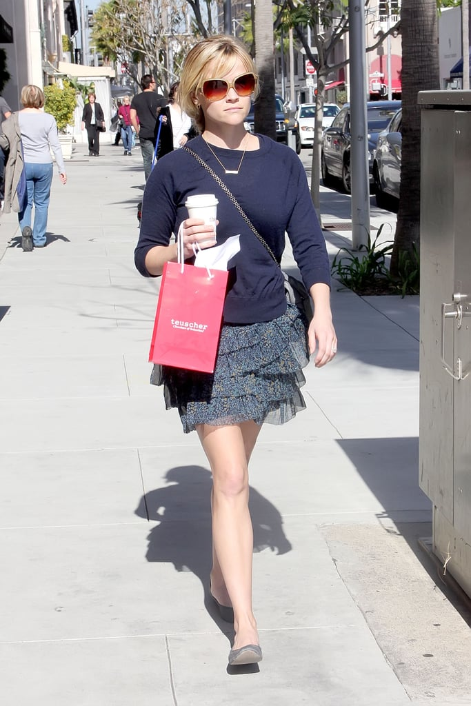 Reese Witherspoon clutched a coffee as she made her way around some shops in the warm Californian weather yesterday. She looked casual after her elegant Oscars appearance, wearing a navy blue jumper and a cute skirt as she browsed some accessories. A brand new Water For Elephants trailer premiered last week, showing her chemistry with her costar Robert Pattinson. The release date is getting closer, as we only have to wait until May 4 to see the whole film for ourselves!