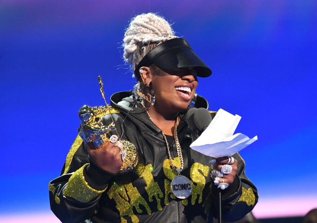 "The MTV Video Music Awards belonged to Missy Elliott on Monday night — everything and everyone else was just background noise. The legendary rapper and hip-hop star hit the stage about halfway through the award show in Newark, NJ, to perform a truly epic set before accepting the Michael Jackson Video Vanguard Award. After dancing and belting out hits like ""The Rain (Supa Dupa Fly),"" ""Throw It Back,"" ""Get Ur Freak On,"" and ""Work It,"" she was introduced by Cardi B and delivered a heartfelt, teary-eyed speech touching on her legacy in the music industry. ""I promised I wouldn't cry because I cry every award [show], but the Video Vanguard Award means so much to me,"" she said. ""I have worked diligently for over two decades. I never thought I'd be standing up here . . . it don't go unnoticed, the support and love you've shown me over the years."" Related: Yep, Missy Elliott Brought Alyson Stoner From Her ""Work It"" Music Video to Perform at the VMAs She went on to thank God, her mother, Aaliyah, Timbaland, Busta Rhymes, Janet Jackson, Peter Gabriel, Madonna, MTV, and more. She also made sure to shout out all the dancers who have helped her music videos reach icon status over the years.  ""Lastly, I want to dedicate this award to the dance communities all around the world. When y'all get on the stage with these artists, y'all are not just props,"" she told the dancers around her, ushering them to the front of the stage. ""Y'all are the icing on the cake, y'all are the beat to the heart. I dedicate this to every dance community out there."" Keep scrolling to watch her speech, as well as see some gorgeous photos from her epic performance. Related: We'd Watch Missy Elliott's VMAs Vanguard Performance on Replay Forever — It's *That* Good"