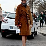 Elisa Nalin pulled together a bundled-up look with a corduroy trench, then finished with metallic heels.