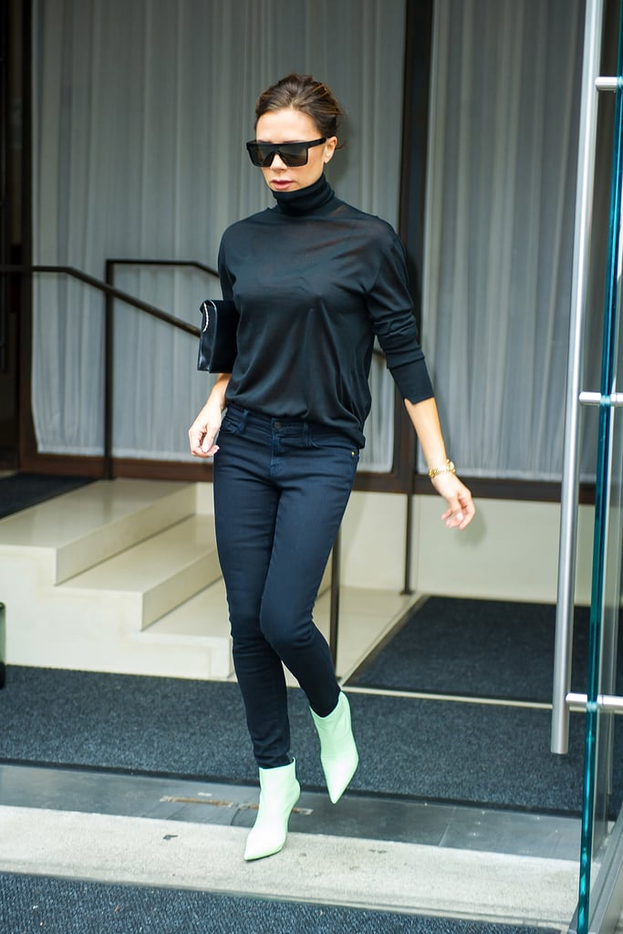 Victoria added a pop of color to her dark outfit with pastel green ankle boots.