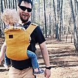 A smiley dad rocking a baby carrier is all we need in this life.