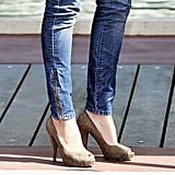 A zoomed-in look at Kate's zipper-detailed skinny jeans and textured peep-toe pumps.