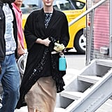 Leighton Meester covered up a formal dress with a robe on set.