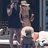 Ashlee Simpson held a beverage during a trip to Cabo in June.