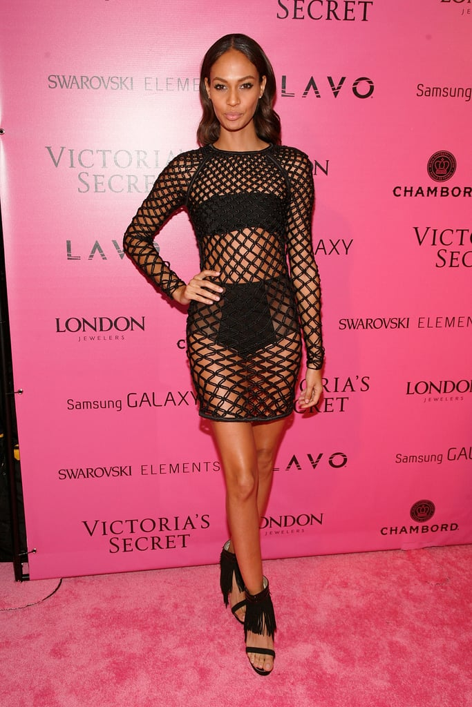 On the 2012 Victoria's Secret Fashion Show red — or rather, pink — carpet, model Joan Smalls left little to the imagination in a mesh Julien Macdonald dress and fringed Nicholas Kirkwood sandals.