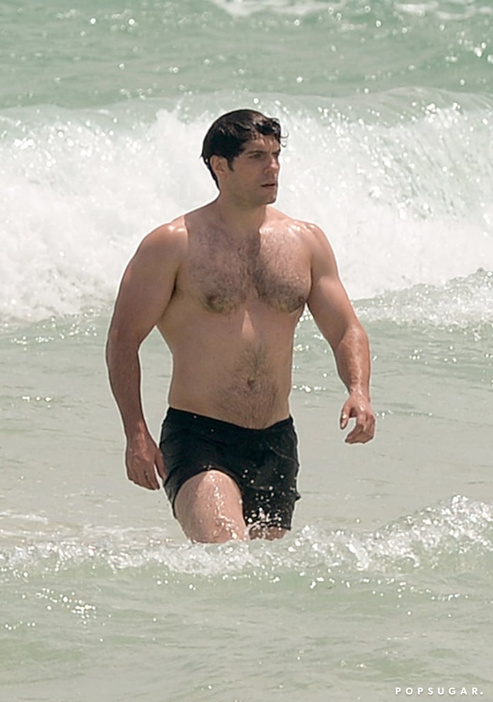 On Tuesday, Henry Cavill spent a sunny afternoon at the beach in Miami, FL. The Batman v Superman: Dawn of Justice actor — who recently cuddled up with Justice League costar Jason Momoa while promoting Suicide Squad — went shirtless and spent time in the ocean, proving that he's still very much in superhero shape from his role as Superman in the DC Comics universe. Of course, if you're worried that Superman's dead, take solace in the fact that he's signed up for the upcoming Justice League films. Suffice it to say, we can look forward to many more moments with his muscular body in the years to come.