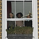 The kids peeked out the window to the streets below.