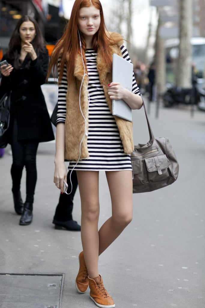 There's so much to love about this look — preppy stripes get a boho twist with a fur vest, not to mention a dose of cool via easy high-tops.