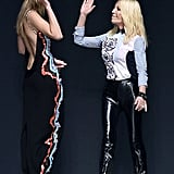 Gigi joined Donatella when the designer took her bow, congratulating her with a high five.