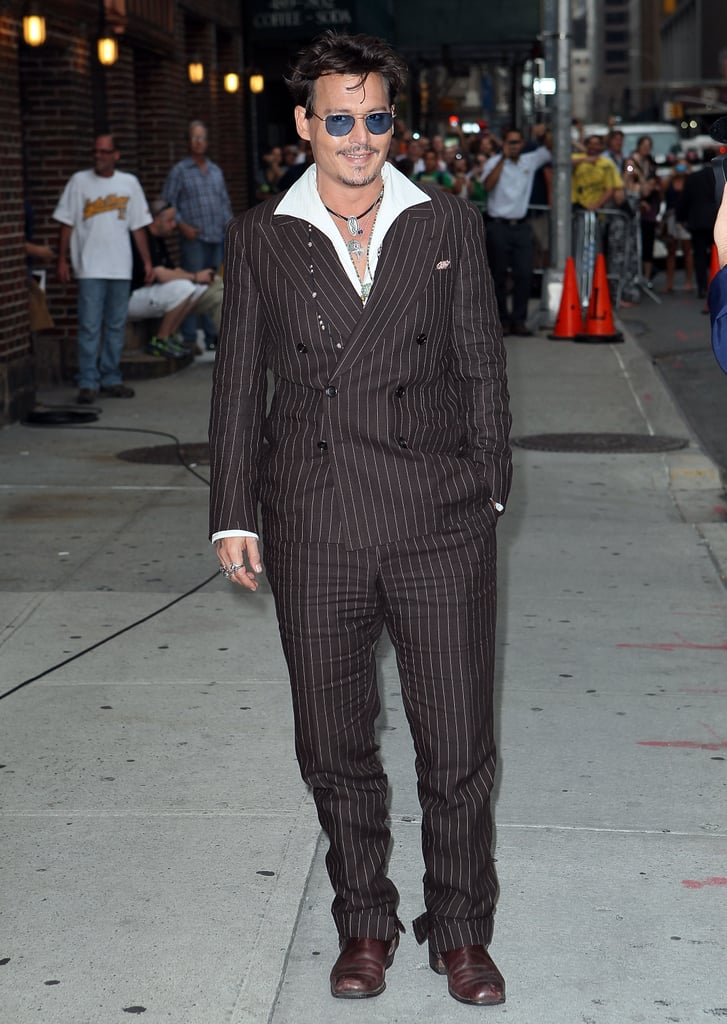 "Johnny Depp wore a double-breasted suit to make an appearance on the Late Show With David Letterman in NYC yesterday. Johnny touched down in the Big Apple to chat up The Lone Ranger in an interview that will air tomorrow night, after his film's star-studded premiere in LA over the weekend. Johnny and his costar Armie Hammer hit the red carpet alongside Julianne Hough, Emma Roberts, Krysten Ritter, and more for the West Coast premiere of the film ahead of its release in the US on July 3. Last week, we got to chat with Johnny at a press day in New Mexico, where he shared details of how his kids ""freed him up"" to have fun on the big screen.  While Johnny has been wrapped up with his Lone Ranger promo tour, he did take time out of his schedule to show his support for a friend earlier this week. Johnny teamed up with Tom Cruise to honor their friend, producer Jerry Bruckheimer, who was awarded with a star on the Hollywood Walk of Fame on Monday."