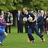 The Duke of Cambridge was all smiles while playing on the palace grounds.