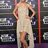 A monochromatic Taylor Swift opted for a vanilla silk georgette Elie Saab gown from the label's Spring 2013 collection.
