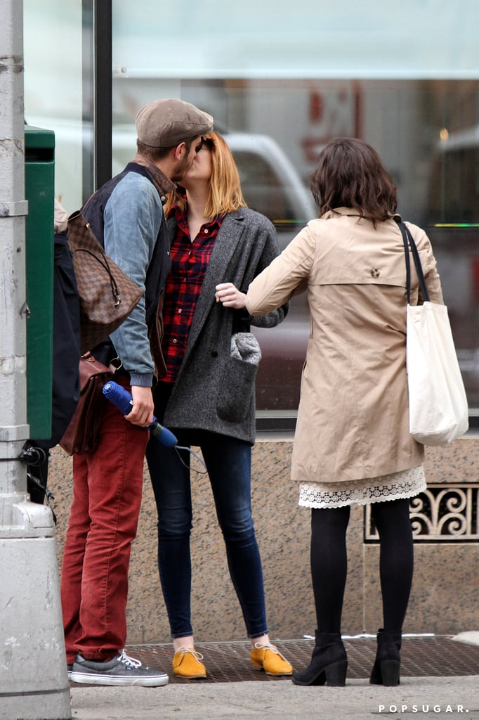 Andrew Garfield and Emma Stone shared a passionate kiss in NYC on Thursday.