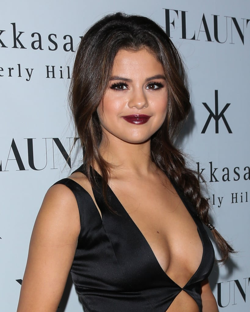 "Selena Gomez went for an edgier look with her revealing black dress and vampy makeup. But even if you're not going for over-the-top sex appeal, you can totally pull off her braid! ""Selena talked about wanting to do a braid, so I knew I wanted to complement the dress with a soft, loose fishtail braid,"" said stylist Richard Collins. He recommends starting with second-day hair, some dry shampoo at the roots, and a little hairspray. Then, use a curling iron to give your hair a little wave. Once your hair has plenty of texture, swing it over your shoulder and braid."