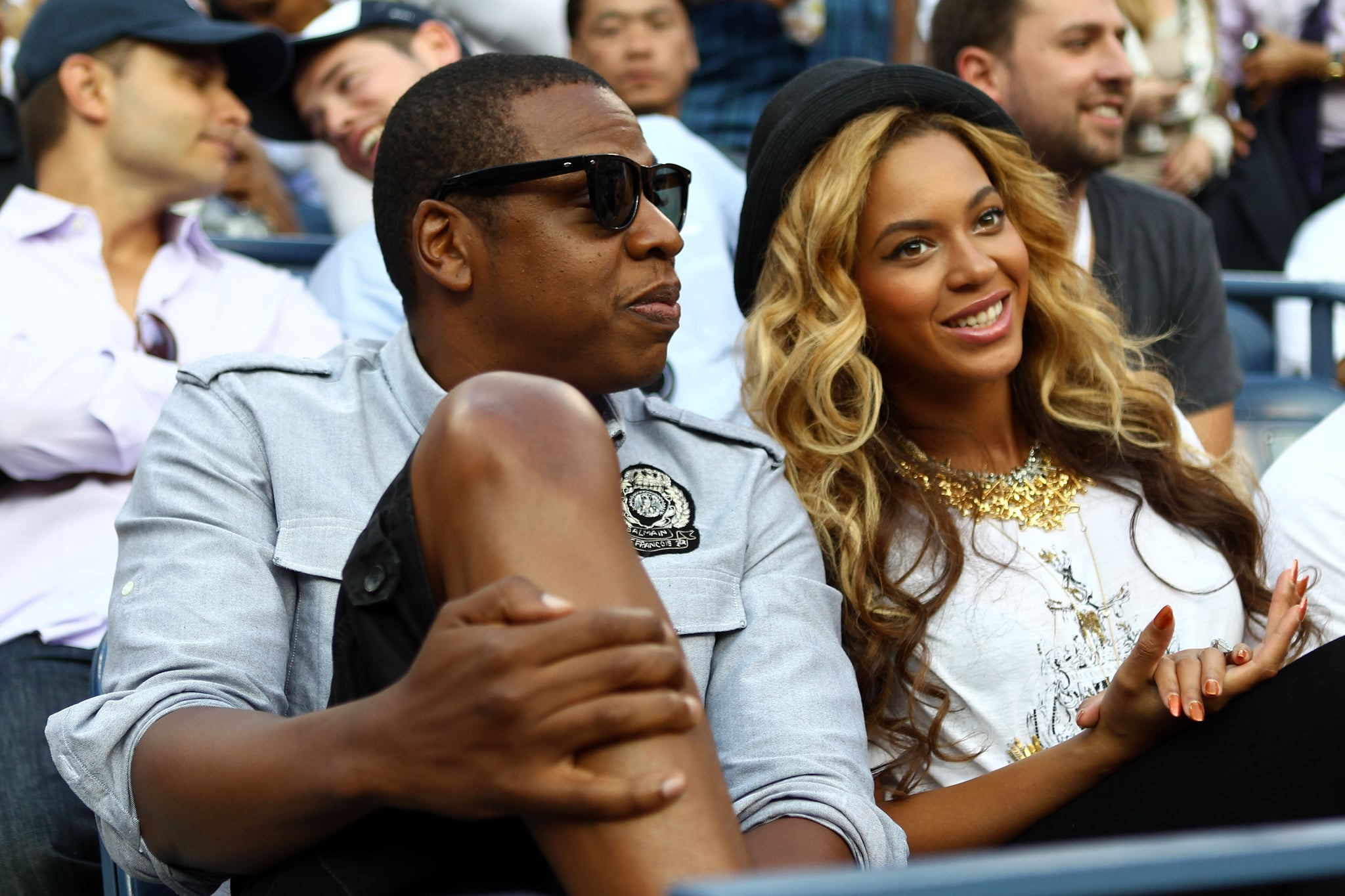 Jay-Z and Beyoncé Knowles watch tennis.