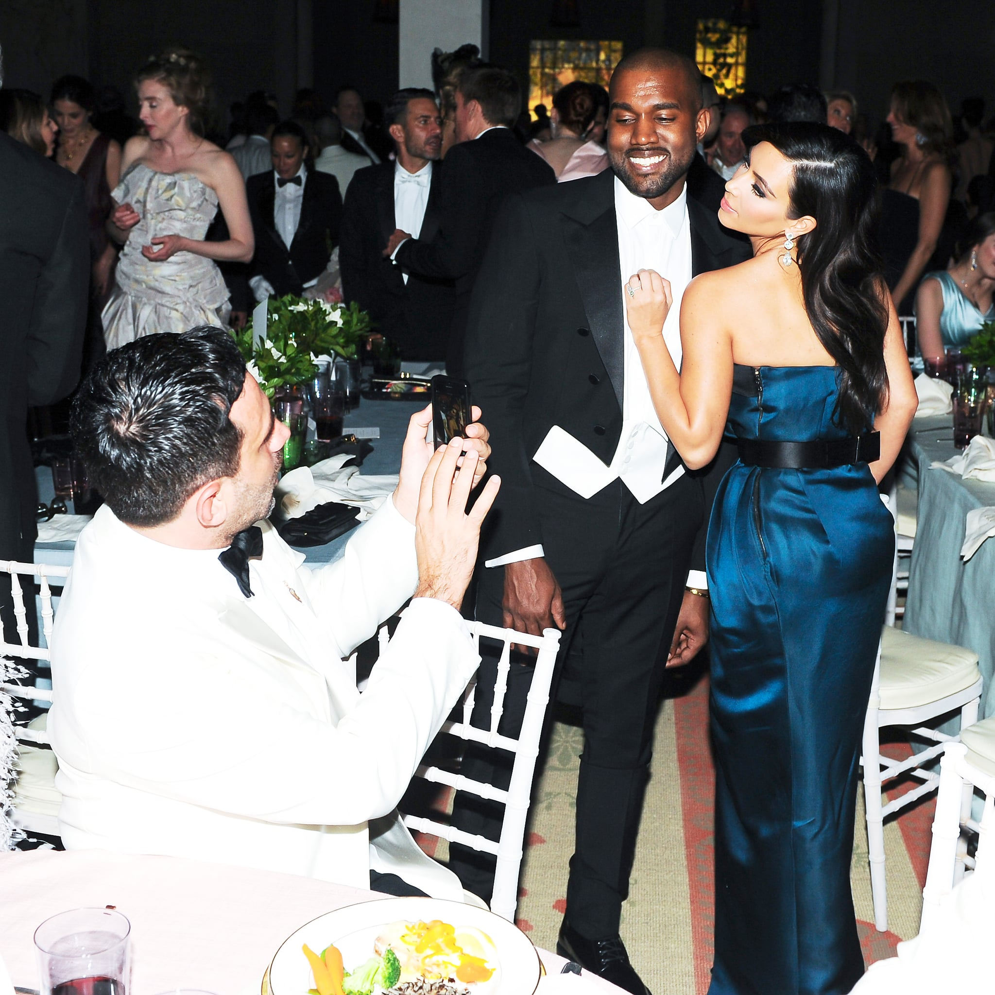 Kim Kardashian struck a pose with Kanye West during dinner.