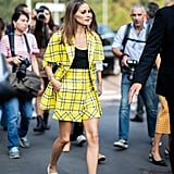 Cher Horowitz, is that you? Olivia's take on that iconic yellow plaid was a cool riff on menswear, right down to the white loafers.