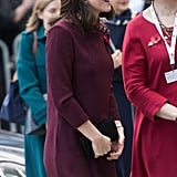 Kate Middleton gave us tiny glimpses of her growing baby bump.