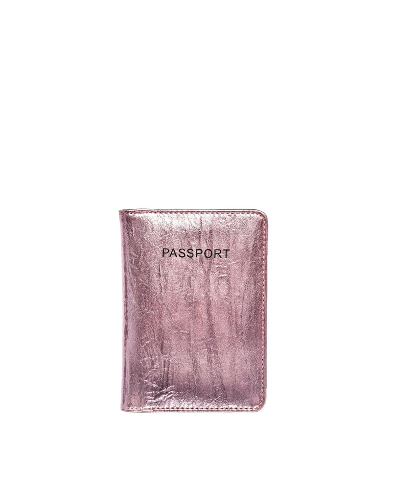 For the world traveler who loves a little glitz, slip this ASOS Passport Holder in Crackle Metallic ($15) into her stocking.