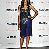 Zoe shimmered in a blue-and-metallic Reed Krakoff dress and Barbara Bui heels at the 2011 Glamour Reel Moments event.
