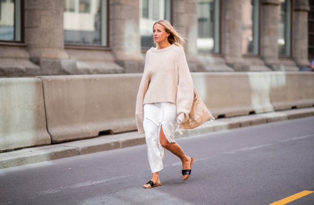 Keep on your slides and go for a leisure-lounge look by throwing an oversize jumper on top of your slitted dress.