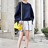 You never have to fear wearing a bright colour with navy since it's just as versatile as black!