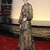 Anne Hathaway wore a moody floral-print long-sleeved gown from Valentino's Fall 2012 Couture collection. The coloring looked great against her skin tone and brunette pixie.