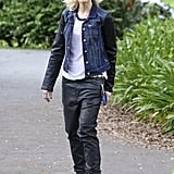 Gwen Stefani was slick in a leather-sleeved denim jacket by Paige Premium Denim, matching black leather baggy jeans, a baseball tee, and high-top sneakers.