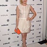 Brittany Snow accessorized with a bright orange clutch.