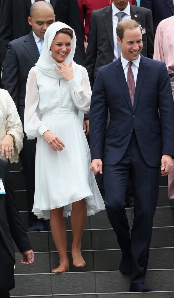 Kate Middleton wore a pale Beulah London dress and draped herself in a headscarf for a visit to a mosque in Kuala Lumpur, Malaysia, on Friday. Kate also removed her nude L.K. Bennett pumps, but still had on her stockings, to enter the place of worship. Kate and William made the appearance together, and afterward they attended a performance in a park. It was William and Kate's first visit to a mosque in their travels abroad, and it's been a royal tour full of new experiences for the duo. Duchess Catherine gave her first speech abroad while Malaysia this week as well. William and Kate's visit to the Far East has been full of cute moments already. As usual, all eyes are on the happy couple, and they're getting even more attention amid the latest Kate pregnancy rumors.