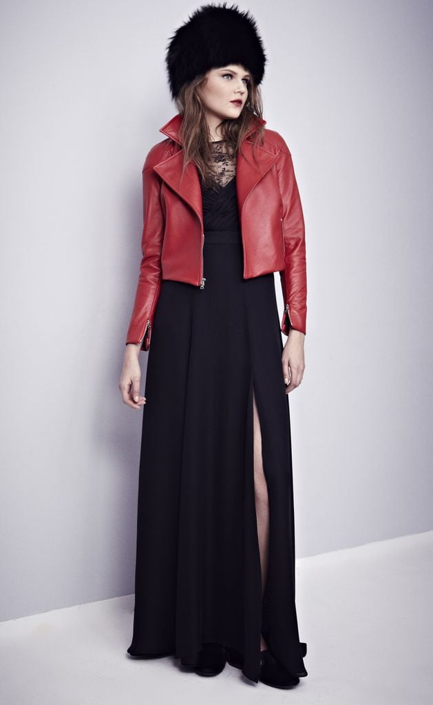 Misha Nonoo's black georgette and French lace gown was made even cooler thanks to the red cropped leather biker jacket and fur hat.