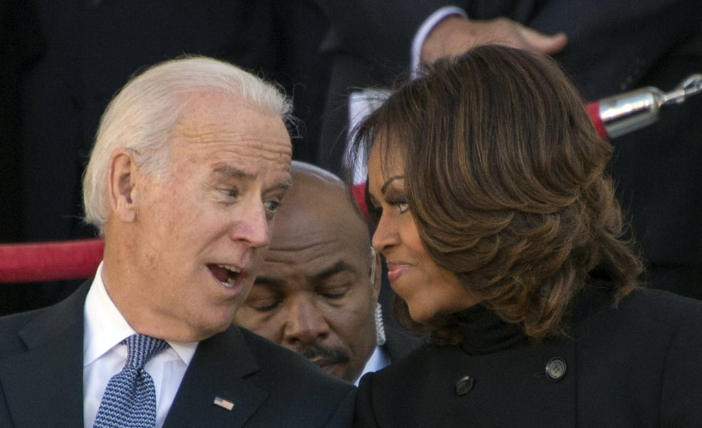 Vice President Joe Biden chatted with First Lady Michelle Obama at Arlington National Cemetery's ceremony.