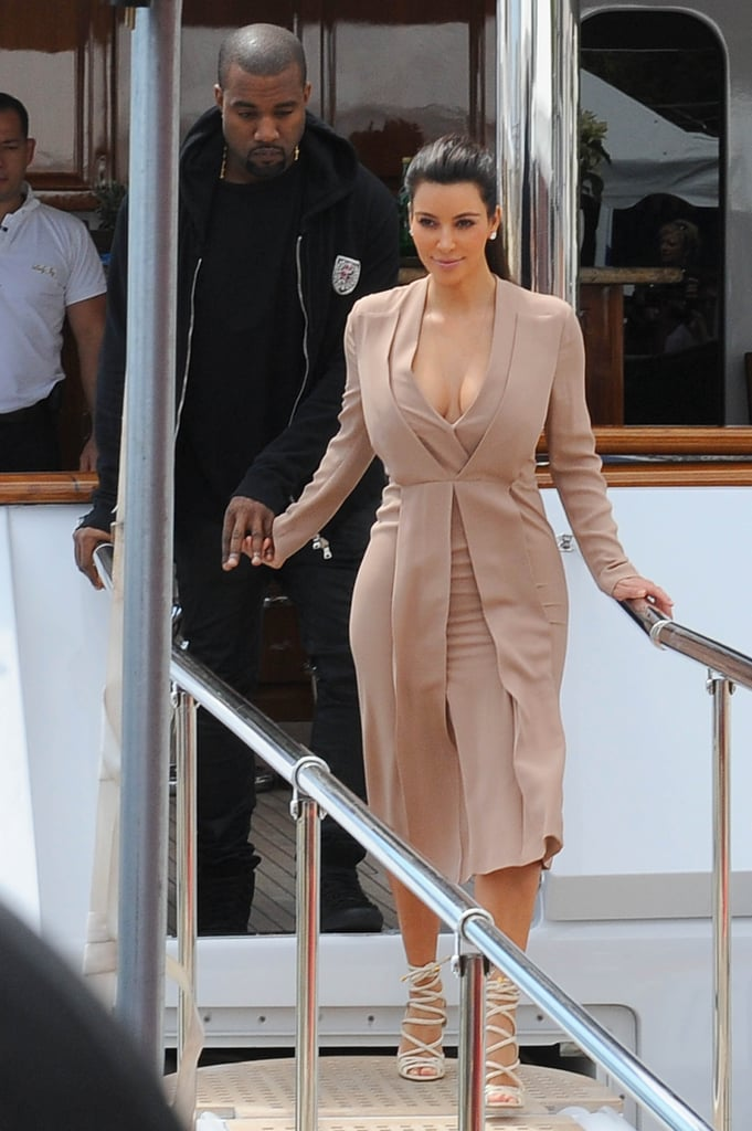 Kanye West and Kim Kardashian held hands as they disembarked a boat in Cannes.