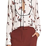 """""""Getting a bit more sophisticated this Fall is as easy as adding a tie-neck blouse, like this pretty printed A.L.C. version ($375) to your closet. Done and done."""" — HWM"""