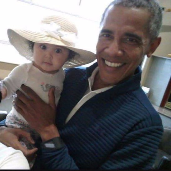 Barack Obama Holding Baby at Anchorage International Airport