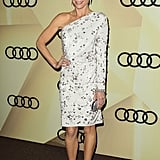 Julie Bowen chose a one-sleeved embellished LWD and accentuated the silver details with a matching clutch and pewter-colored pumps.