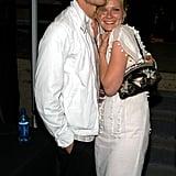 Jake Gyllenhaal embraced Kirsten Dunst backstage of the 2003 MTV Movie Awards.