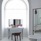 Whitewashed walls and marble-tiled floors give Lori's bathroom a glamorous Old-meets-new Hollywood feel.