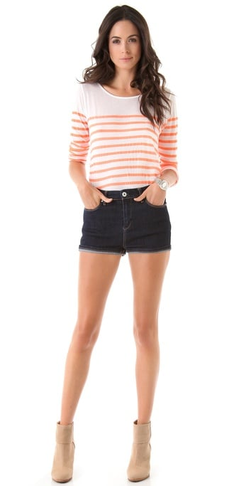 This retro pair of shorts will look great with a bandeau bikini top — sexy beach siren alert. Blank Denim High Rise Cuffed Shorts ($78)