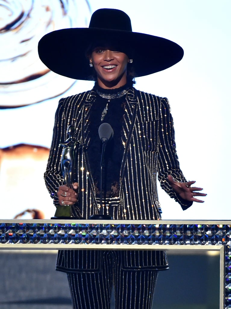 "Just when you thought the CFDA Fashion Awards couldn't get any hotter, Beyoncé shows up. On Monday night, the ""Formation"" singer took a break from her world tour and popped up to accept the coveted fashion icon award. Clad in sparkly, striped pantsuit the star was all smiles as she took the stage and gave her acceptance speech. Also in attendance were Beyoncé's husband, Jay Z and daughter Blue Ivy Carter, who were seen arriving at the fete earlier that evening. See more of Beyoncé now, then check out her recent NYC outing with Jay Z."