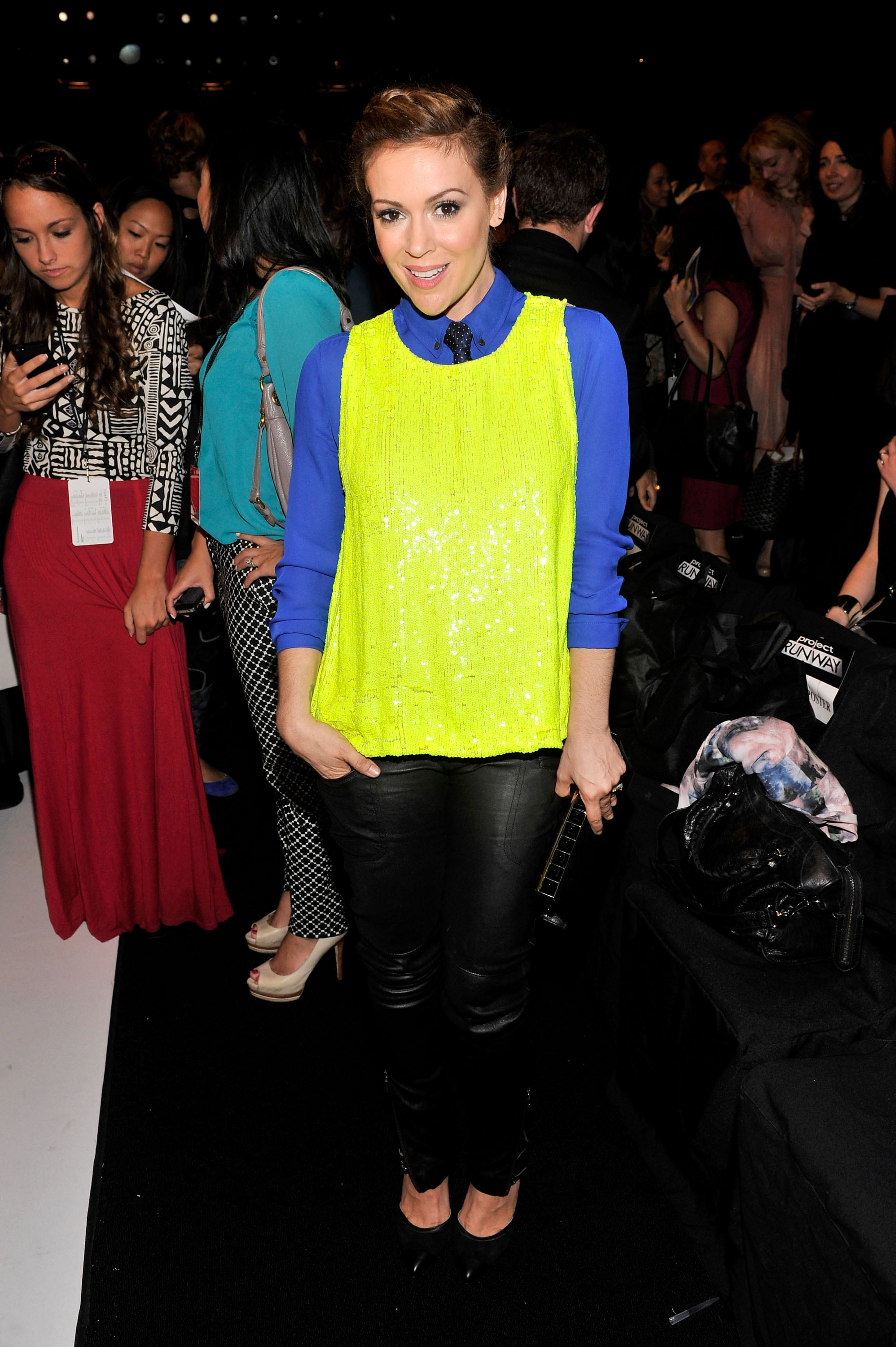Alyssa Milano wore standout brights for the Project Runway show on Friday.