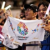 They held up signs and lights for Tokyo 2020.
