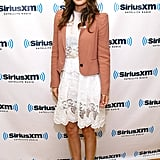 In a pretty peachy color, the blazer's perfectly in tune with the soft vibe of Rachel's lacy Suno dress.