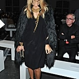 Rachel Zoe topped off a black dress and statement gold jewelry with a luxe fur coat, in the shiniest black hue, at Givenchy.