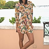Wearing a tropical romper with white Mary Janes.